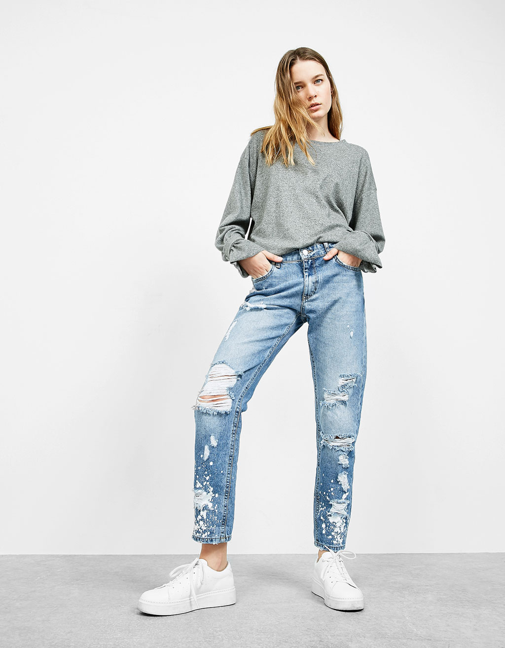 Bleach-stained slim-fit ripped boyfriend jeans