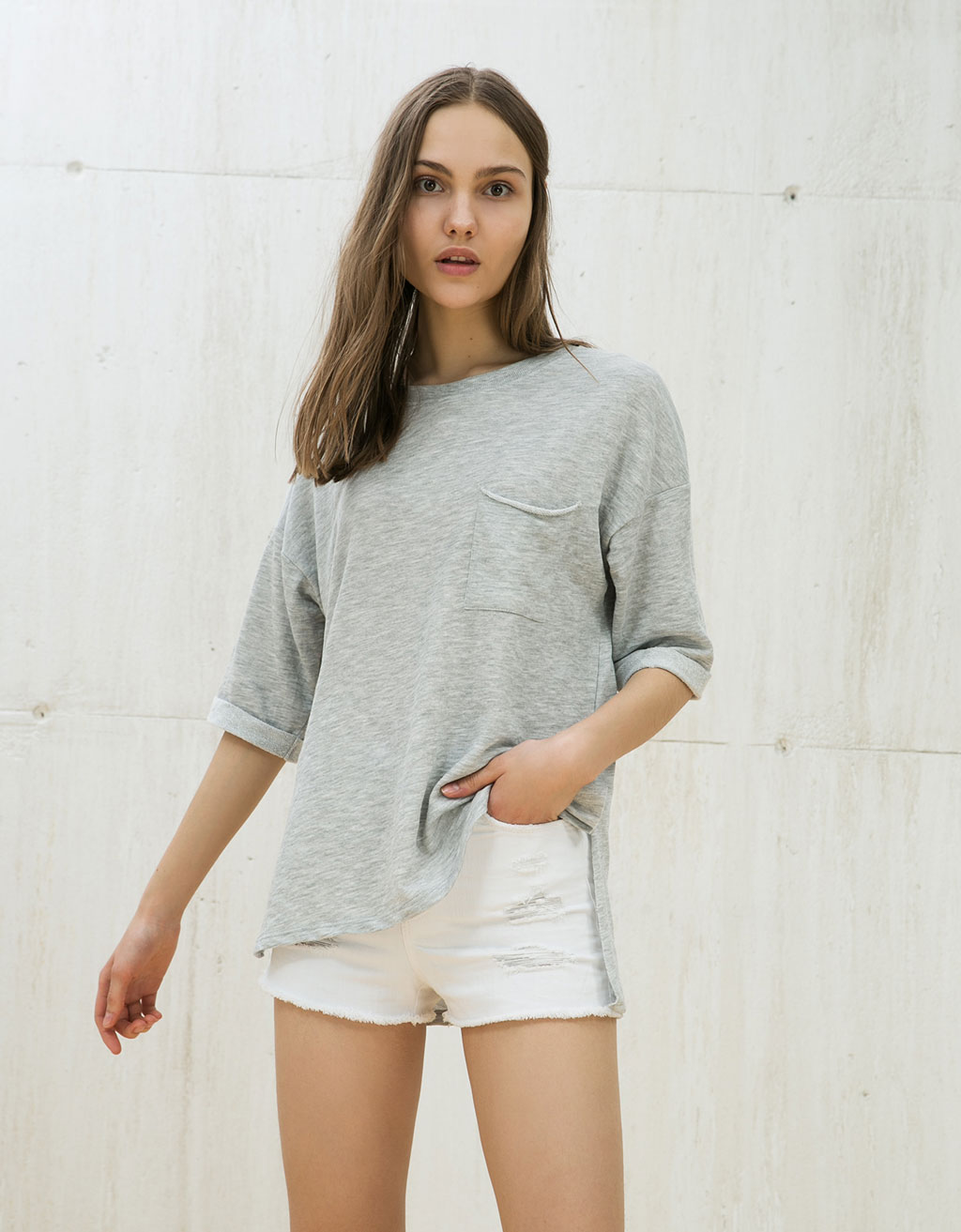 Oversized sweatshirt with short rolled up sleeves