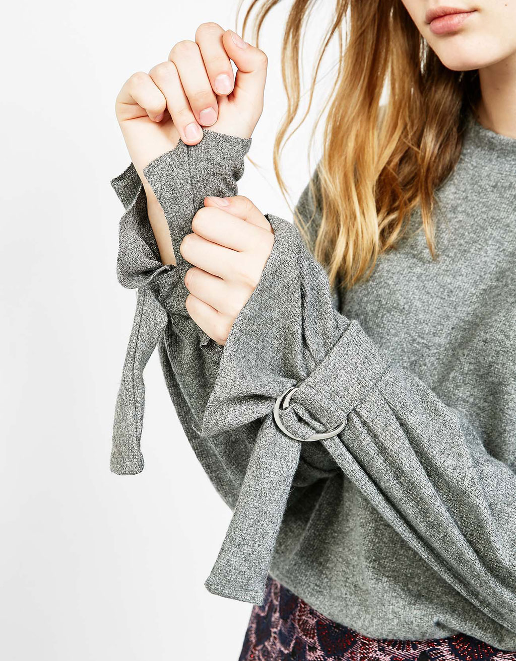 Pull boucles aux manches