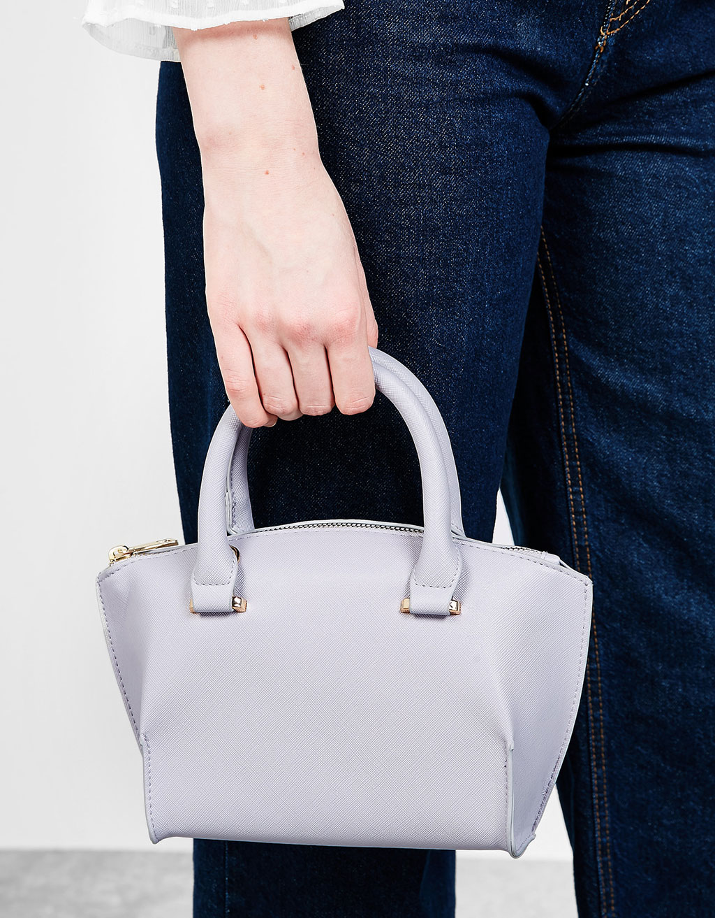 Textured bag with handles