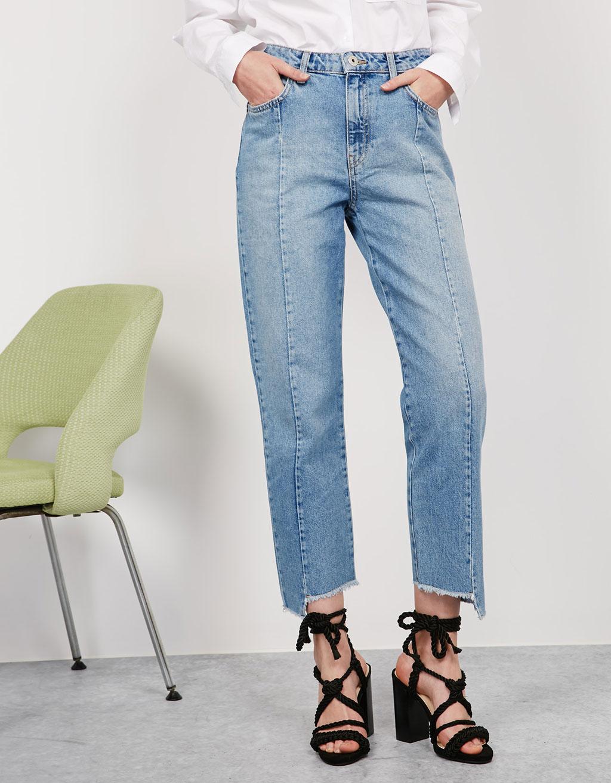 Straight leg asymmetric hem jeans