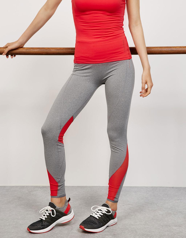 Augstas jostasvietas tehniski sporta legingi kontrastējošās krāsās