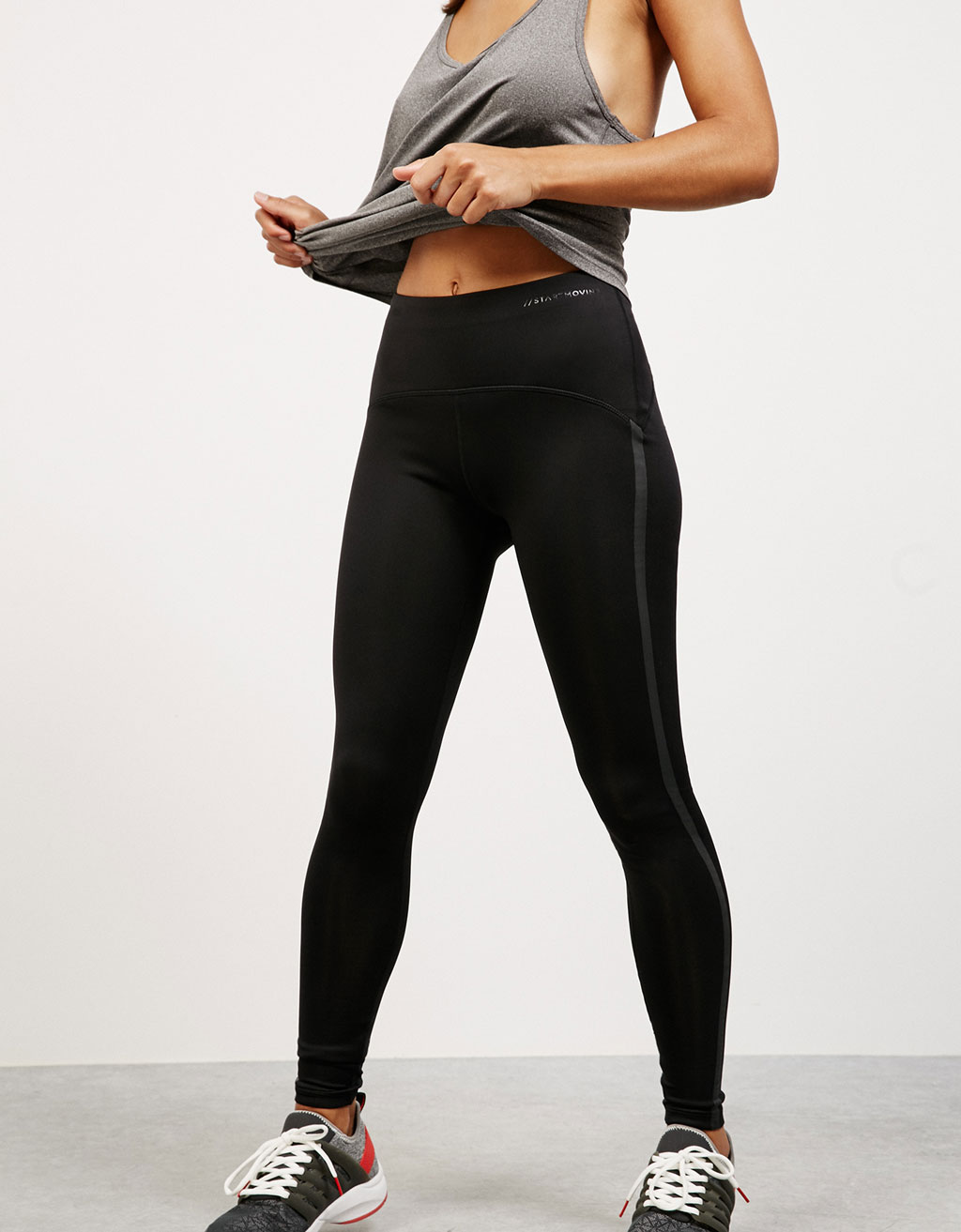 Technical sports leggings with side band