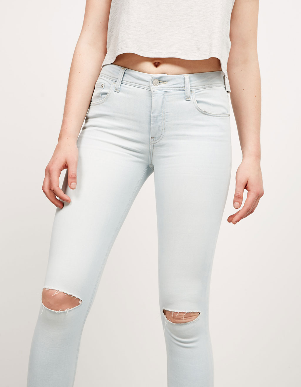 BSK ripped skinny jeans with irregular hem
