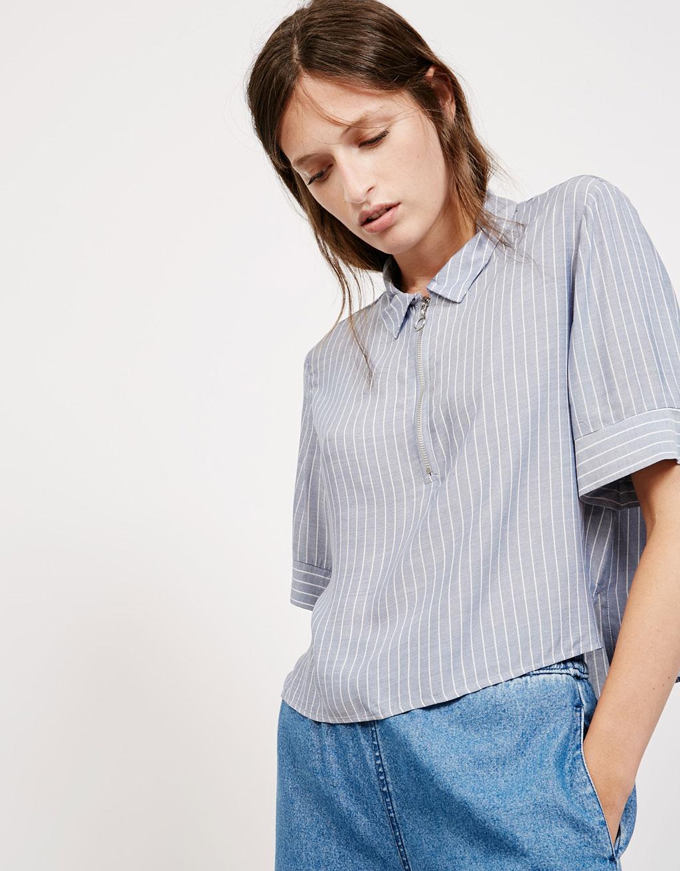 Camisa màniga curta ratlles cremallera