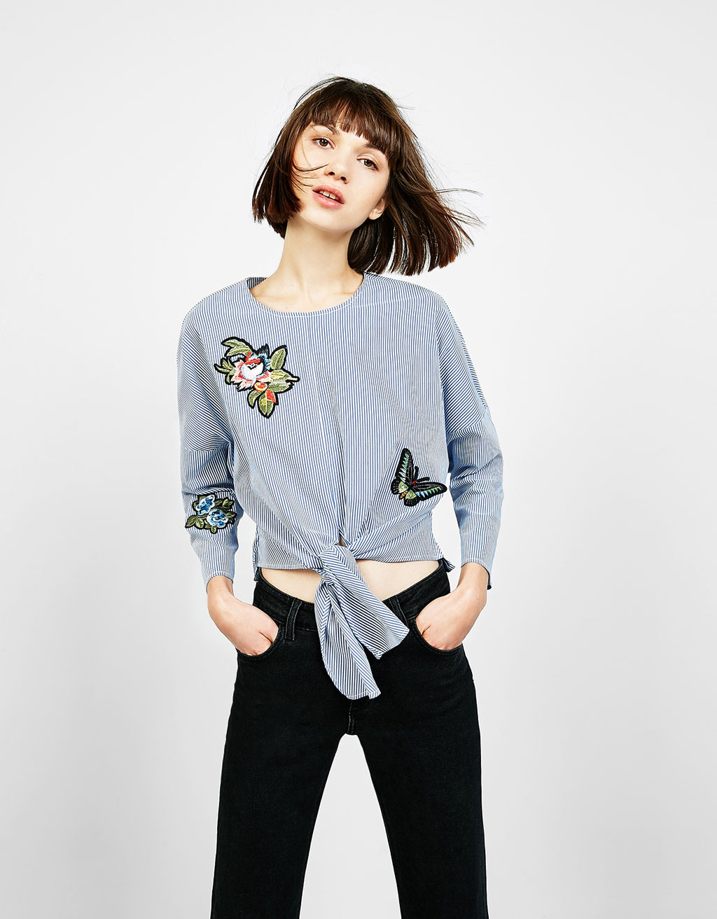 Blouse with 3/4 sleeves, knot and floral patches