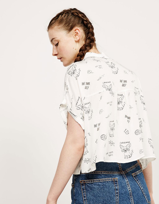 Camisa estampada i amb butxaques