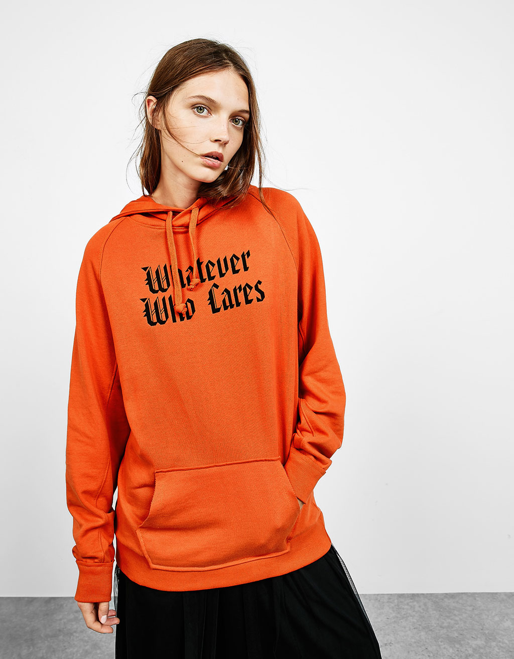 Orange sweatshirt with gothic text