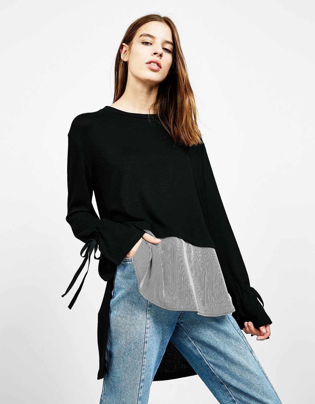 Long sweater with a striped hem