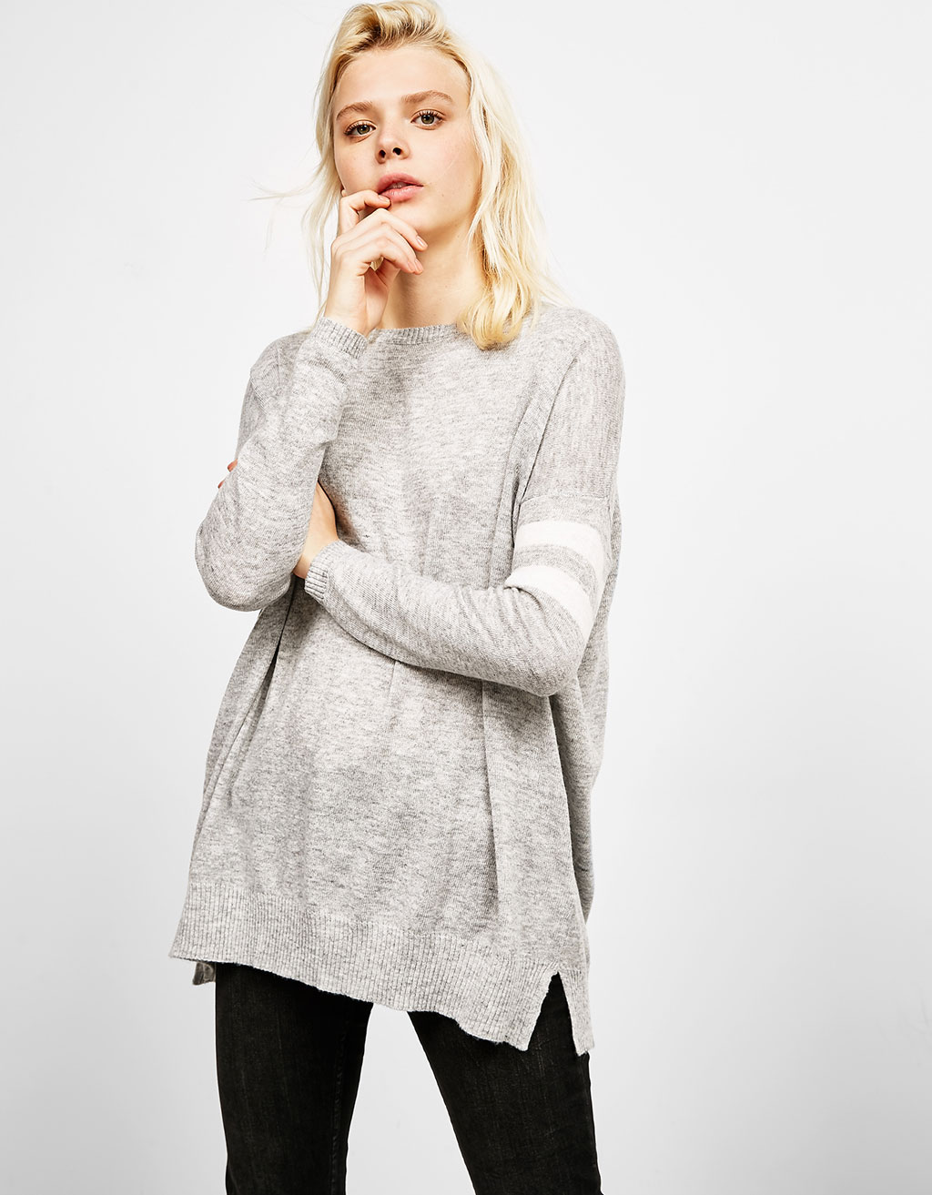 Oversized jumper with striped sleeves