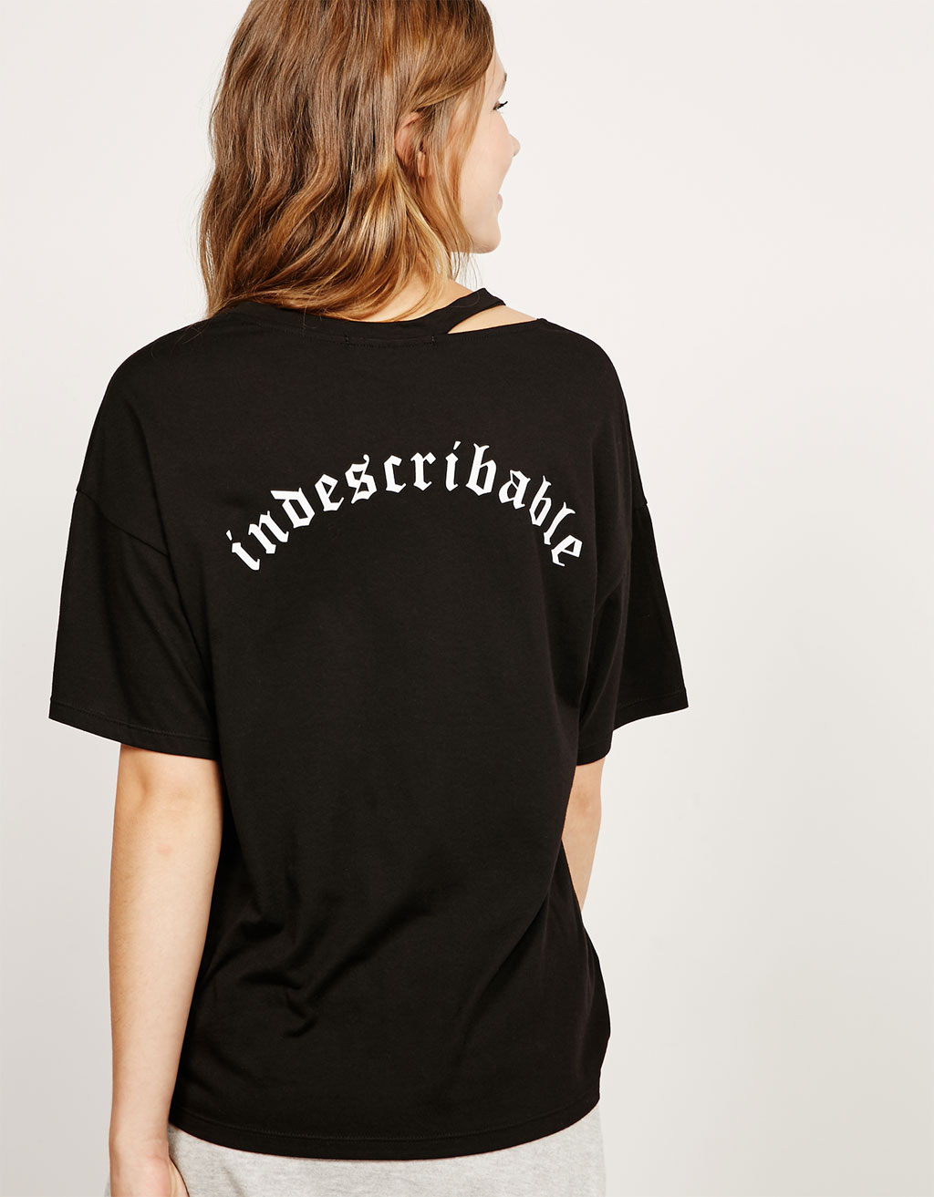 Open neck top with text on back