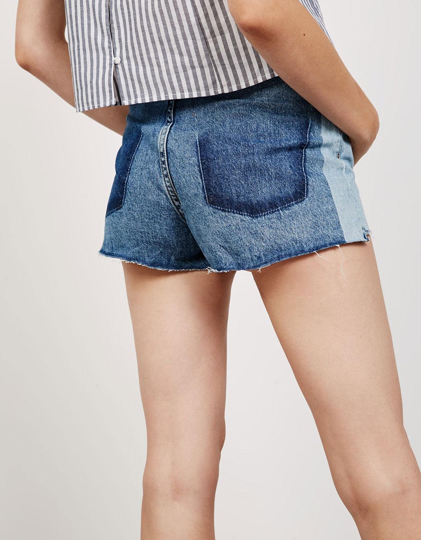 Short en jean taille haute contrastes