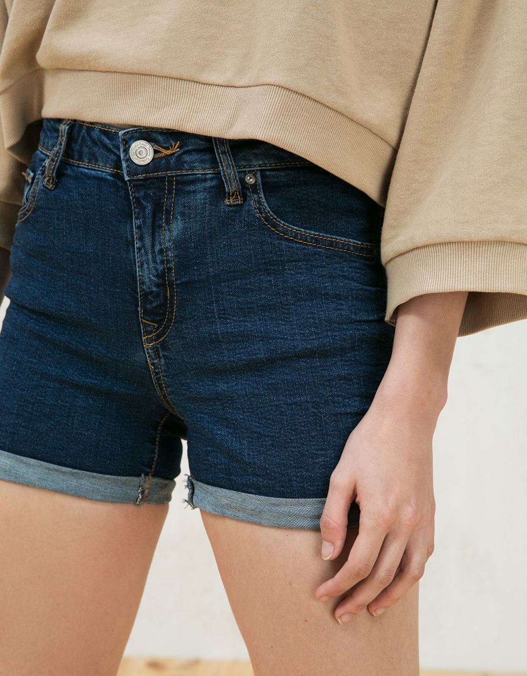 Denim shorts with rolled up hem