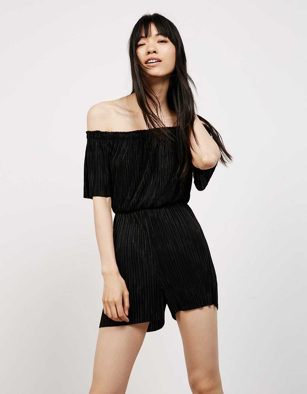 Short micropleated jumpsuit with Bardot neckline