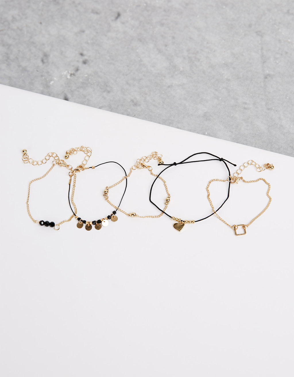 Black and gold bracelets (set of 5)