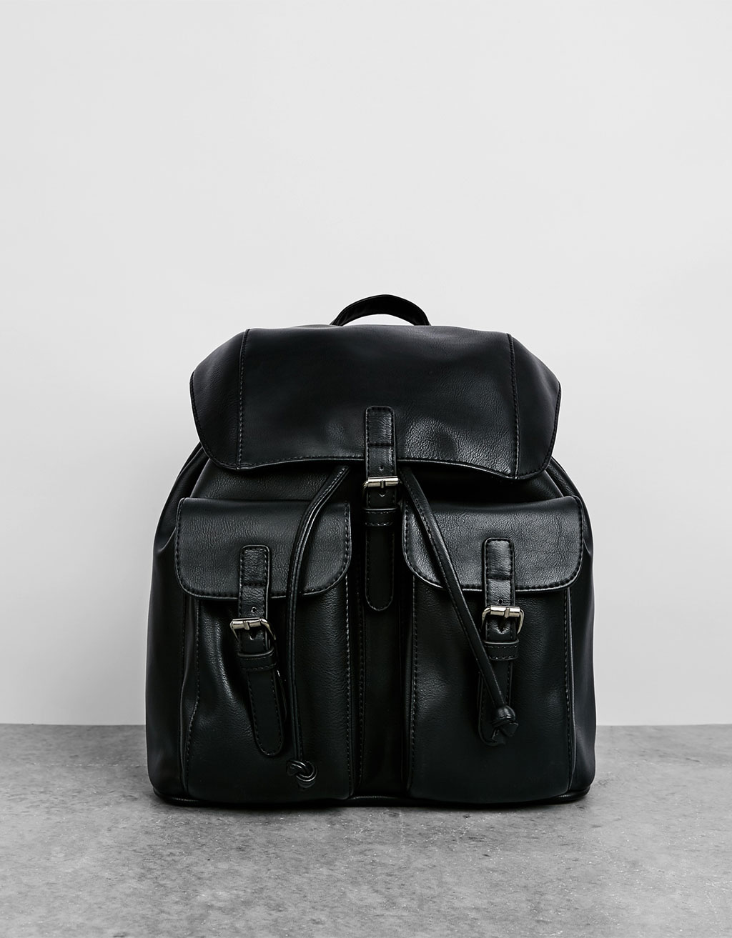 Black imitation leather backpack