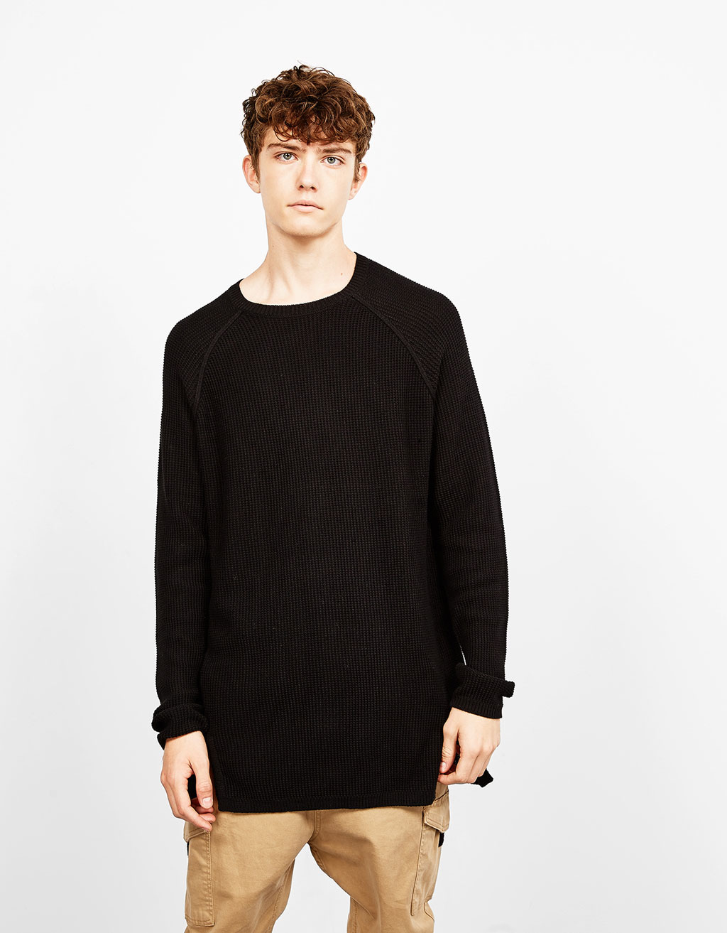 Twist seam sweater with slits