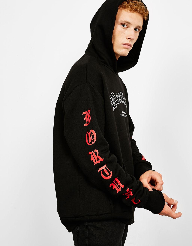 Sweatshirt met capuchon en tekst