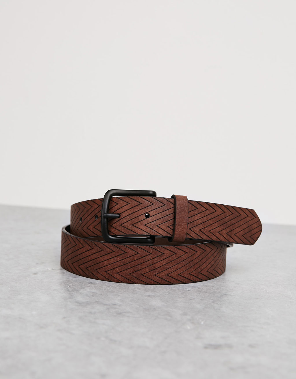 Geometric embossed belt