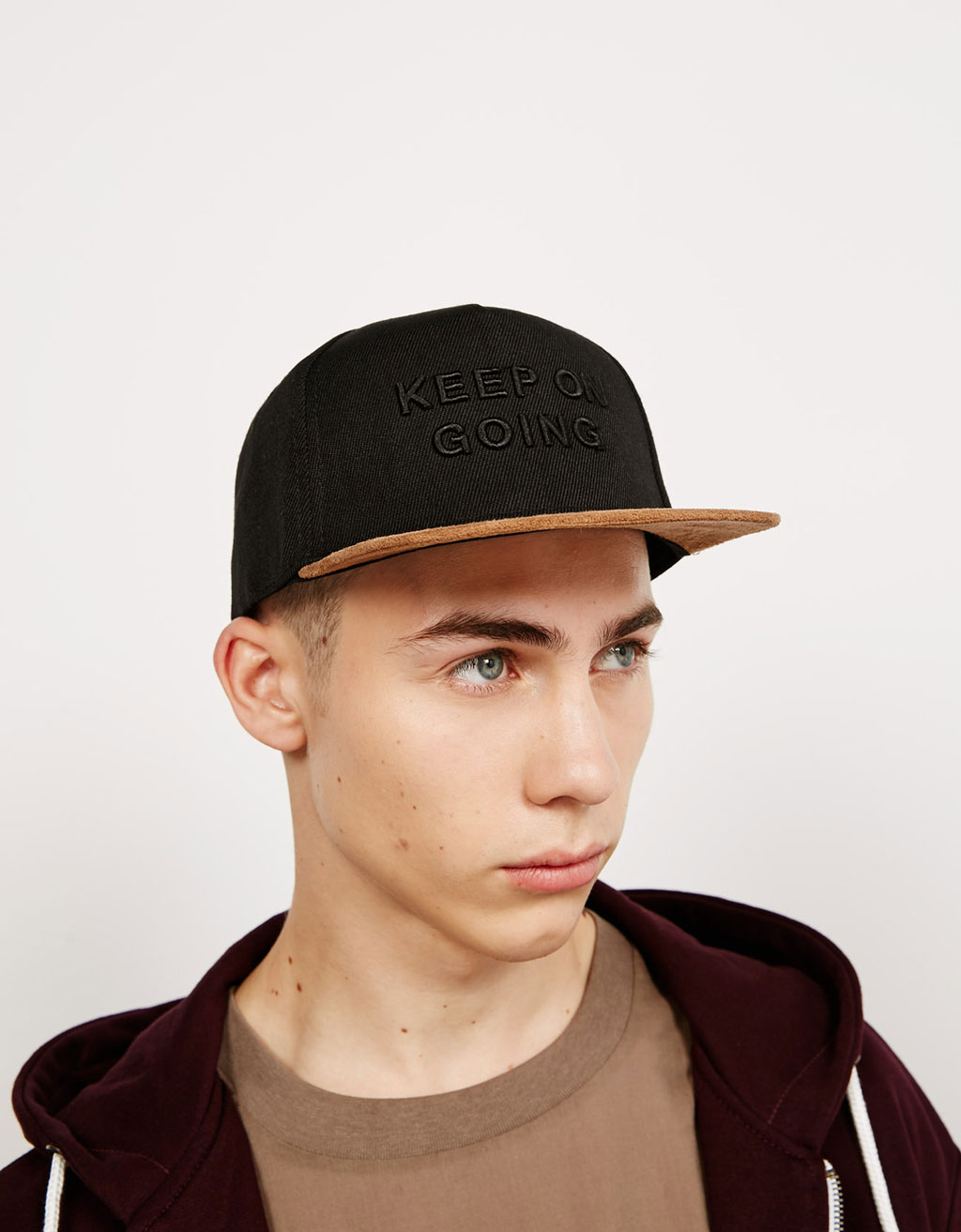 Text cap with leather style visor