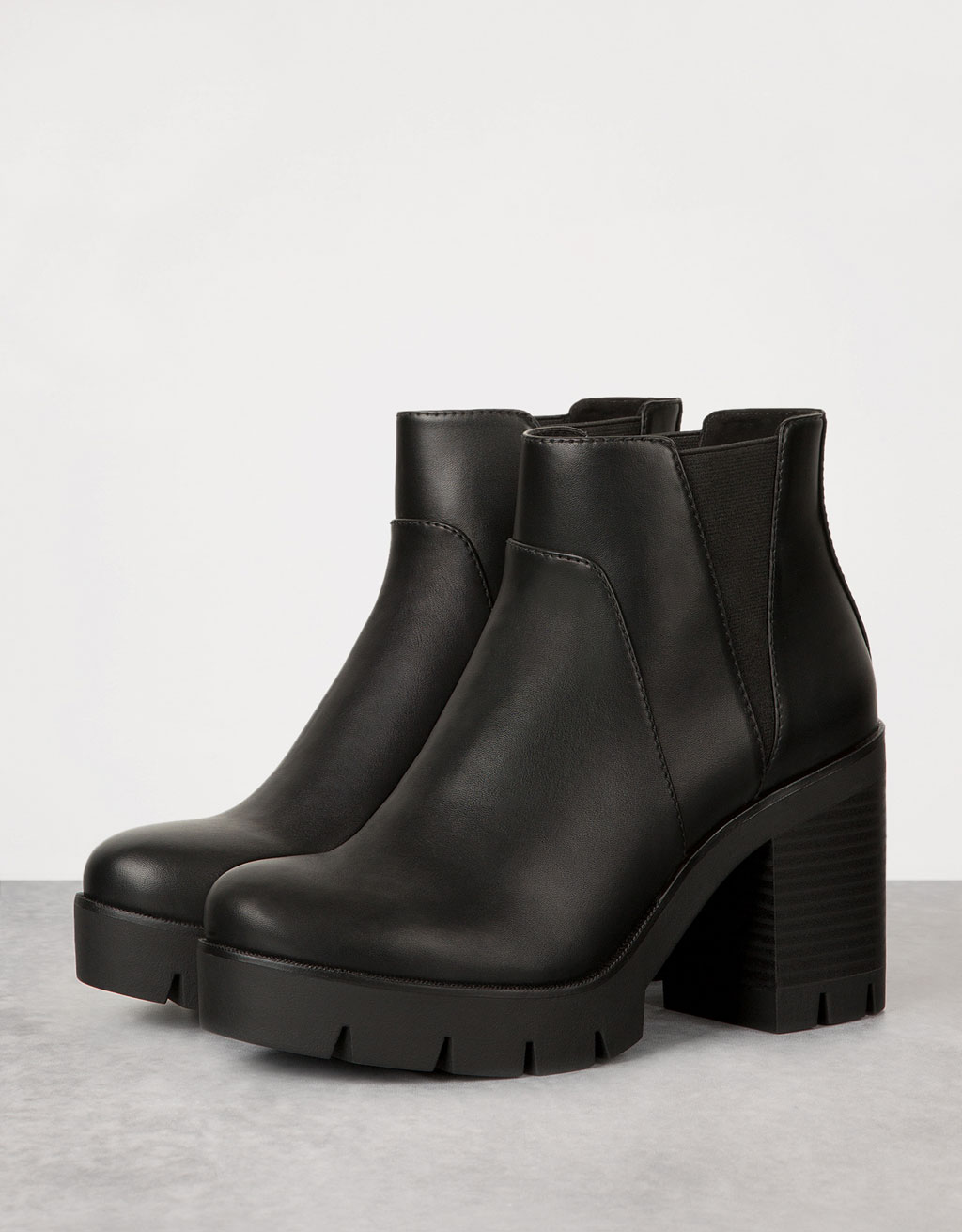 Platform ankle boots with track sole and stretch bands