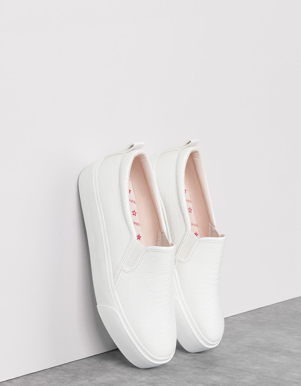 Single-colour embossed sneakers