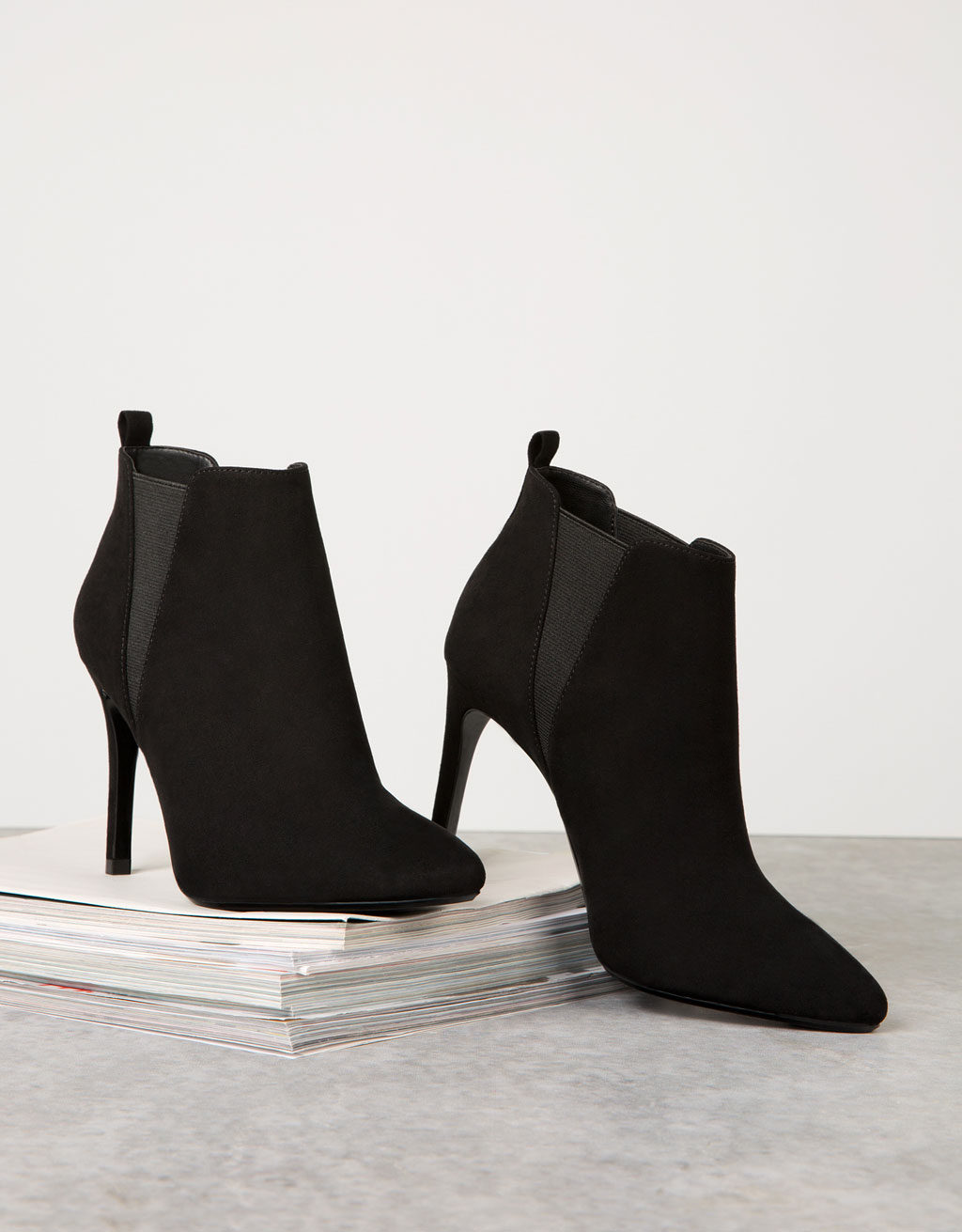 Ankle boots with elastic detail
