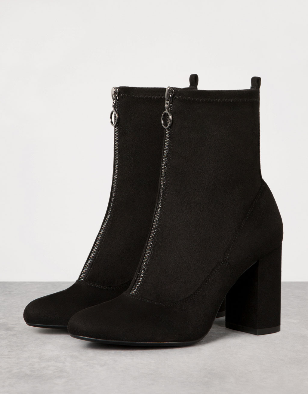 Elastic ankle boots with front zipper