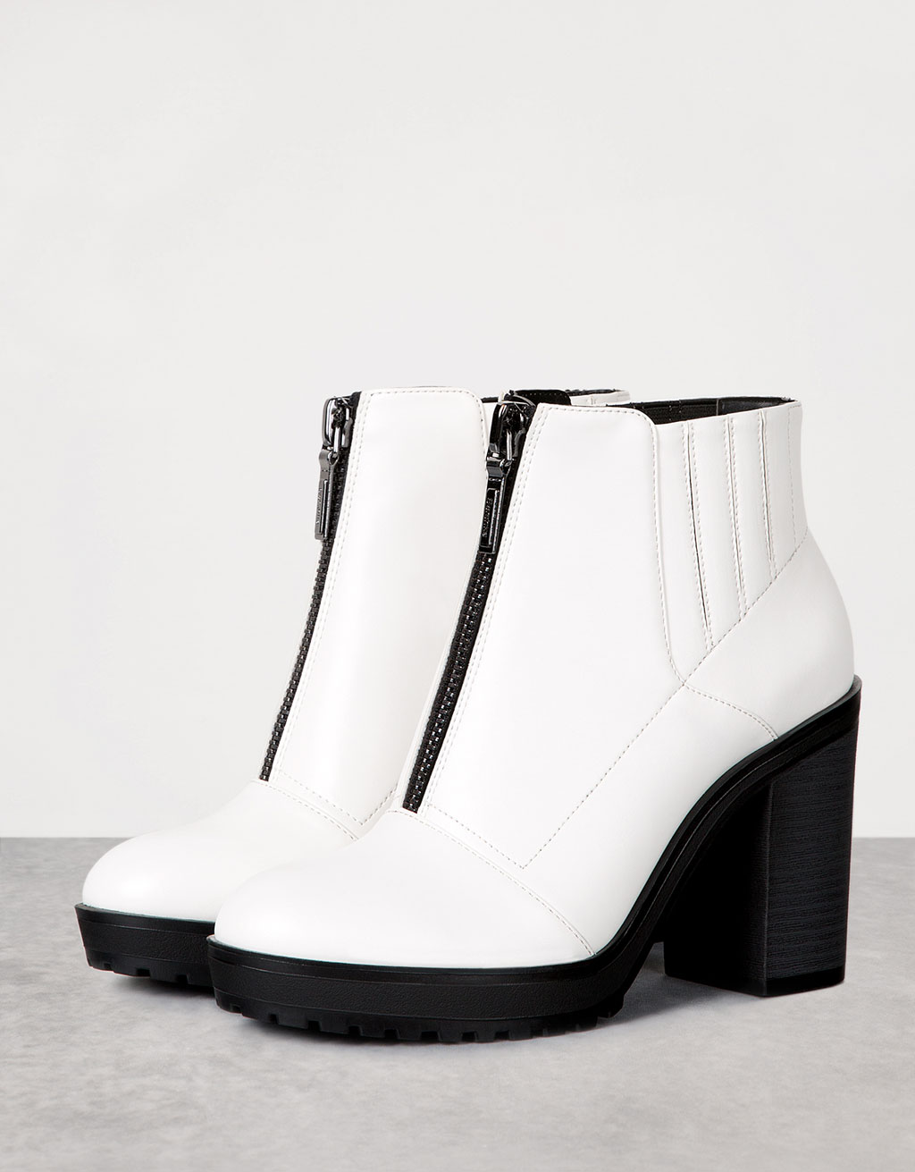 Heeled ankle boots with front zipper