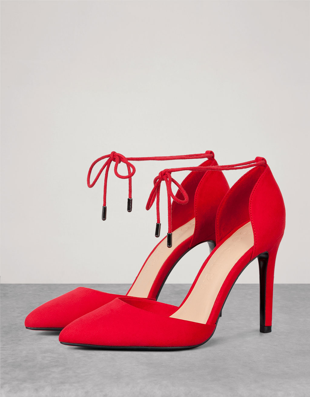 Strappy high heeled shoes