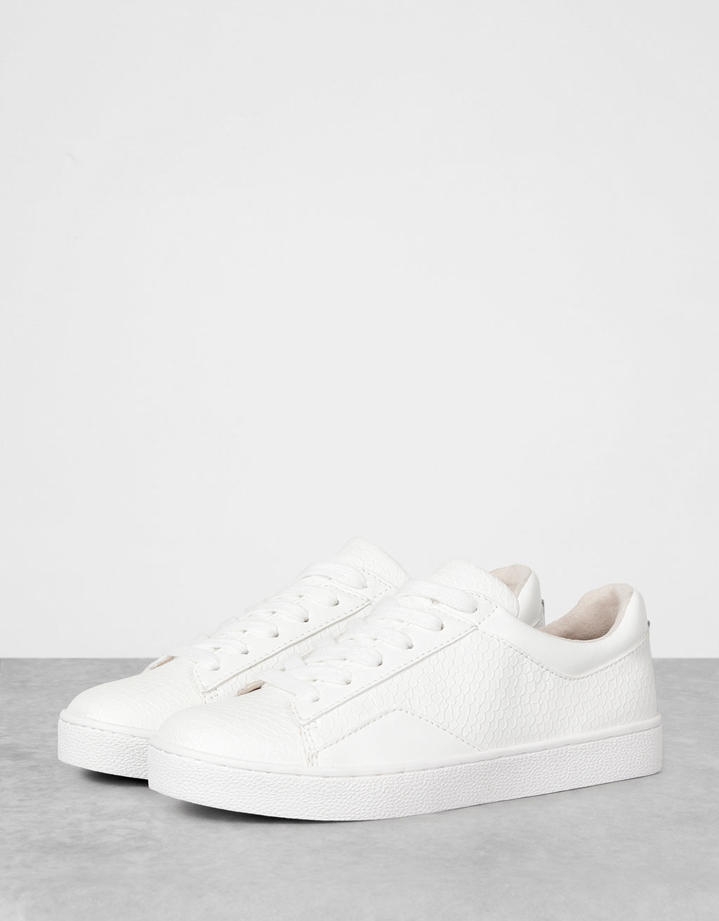 Embossed single-colour sneakers