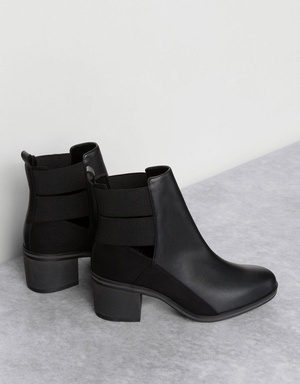 Open, elastic mid heel ankle boots