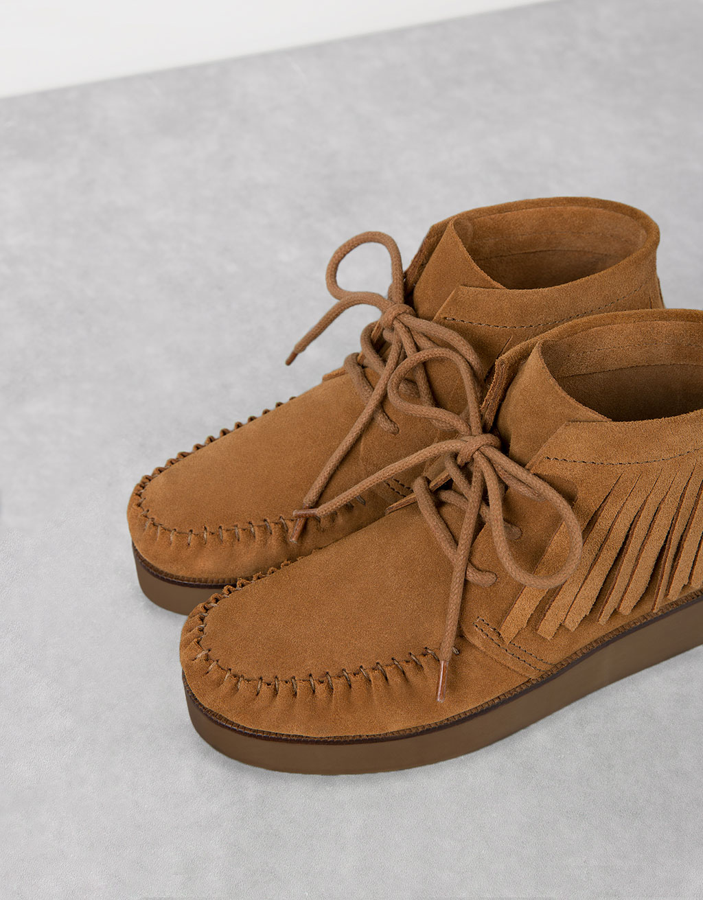 LEATHER platform ankle boots with fringe detail