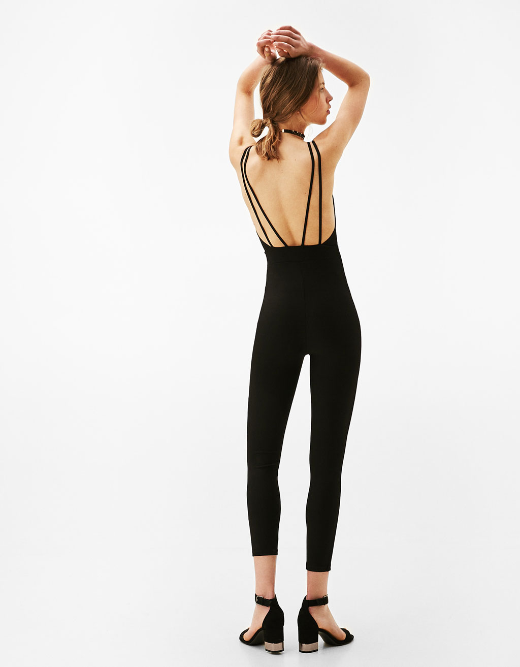Technical jumpsuit with adjustable straps