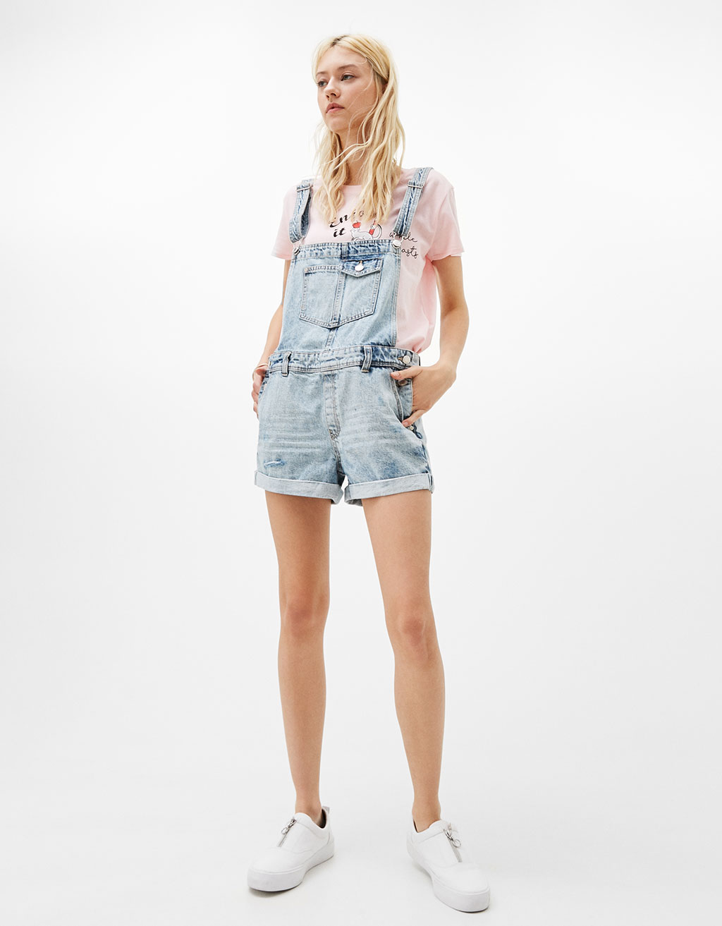 Rolled-up denim dungarees