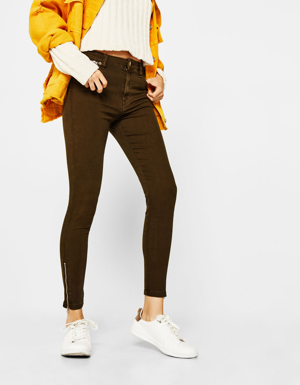 Trousers with zips on the hem