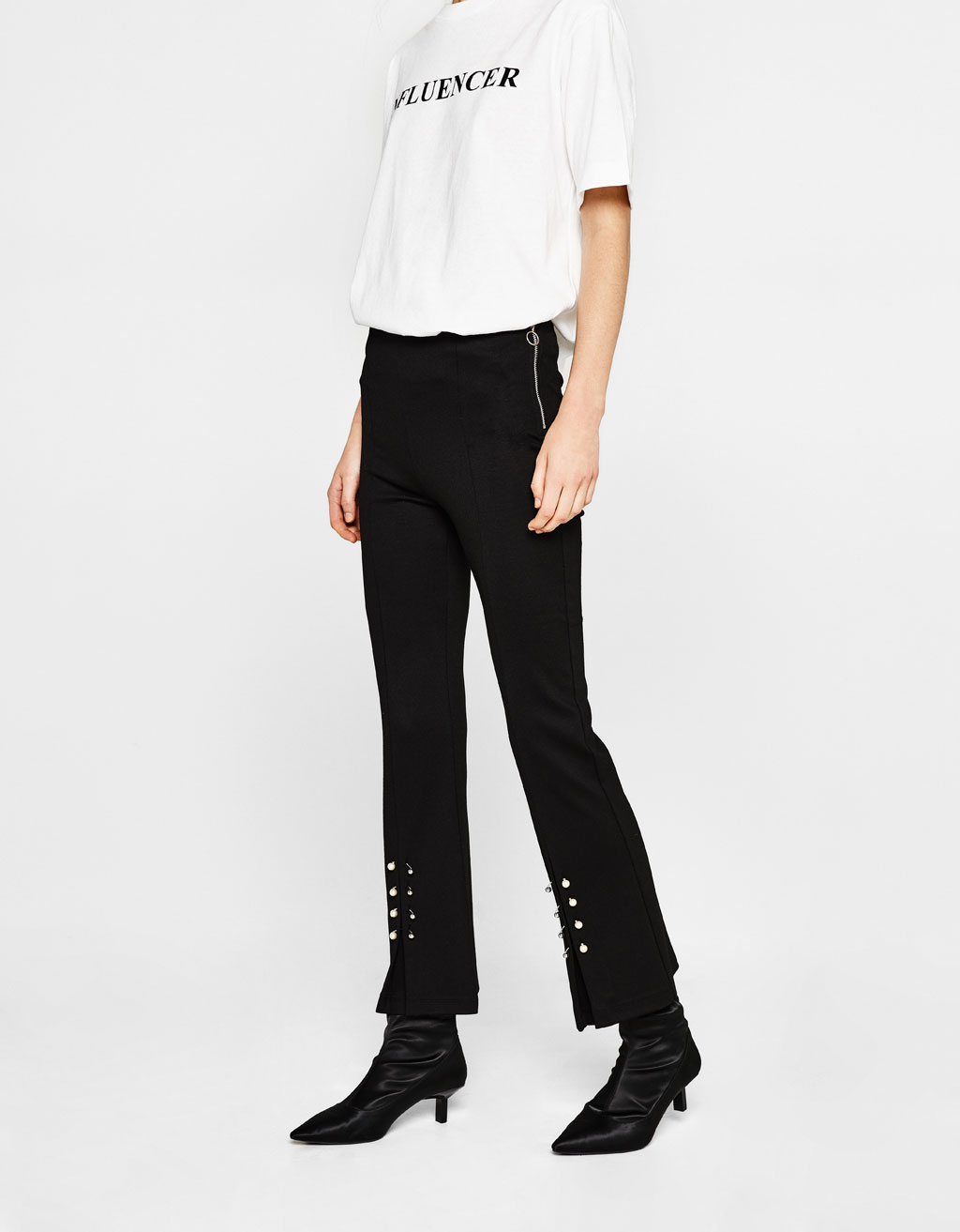 Flared cropped trousers with piercing detail