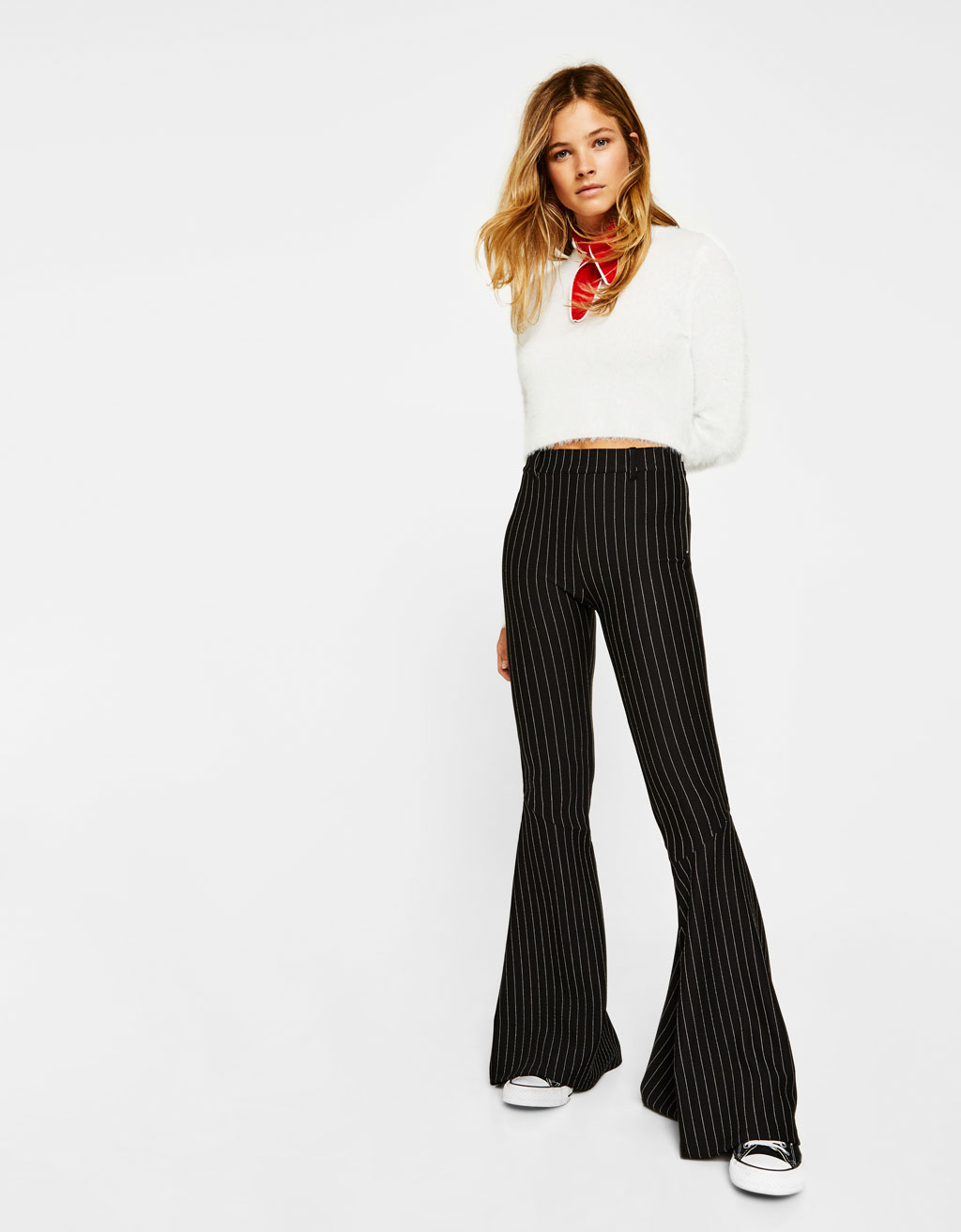 Slim flared pants with maxi ruffles