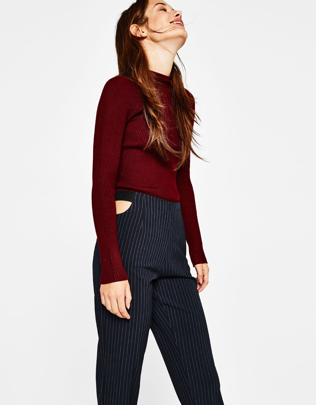 Trousers with cut out waist