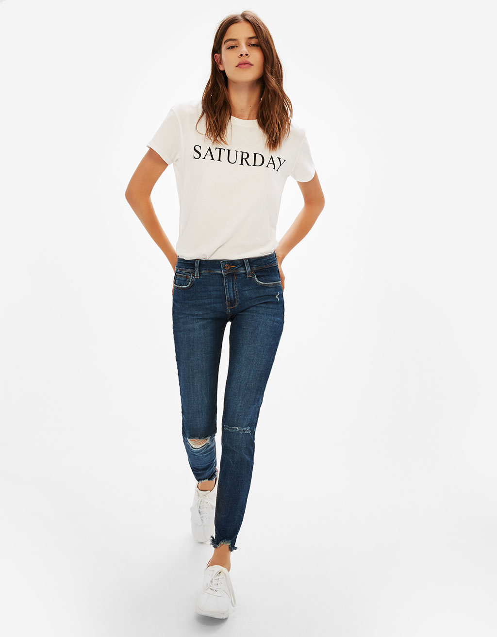 Cropped low-rise jeans with asymmetric hems