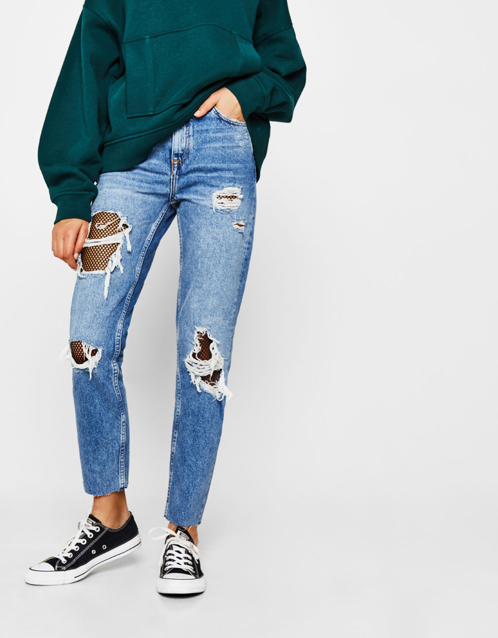 Ripped mom fit jeans with mesh knees
