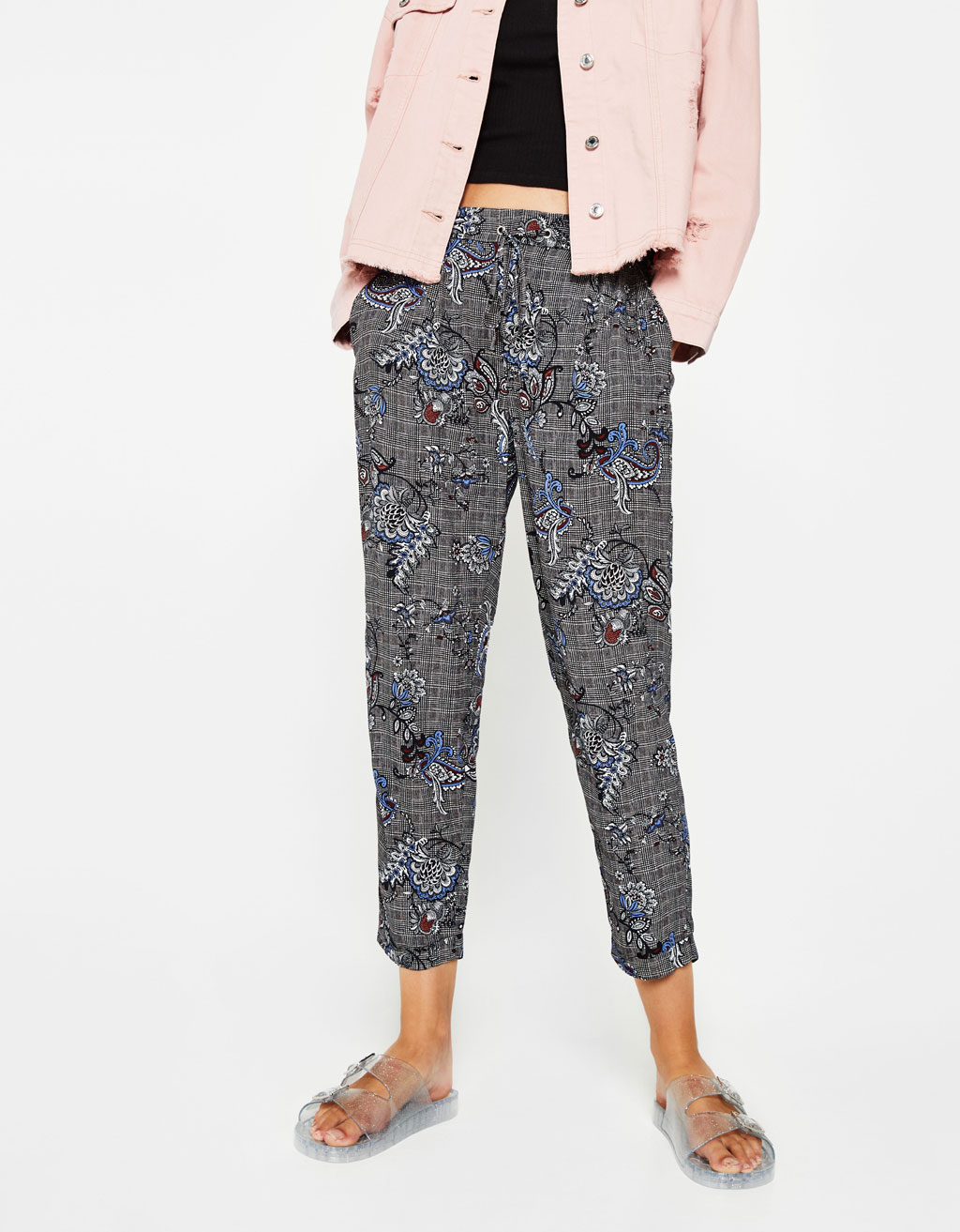 Checked jogging trousers with all over print