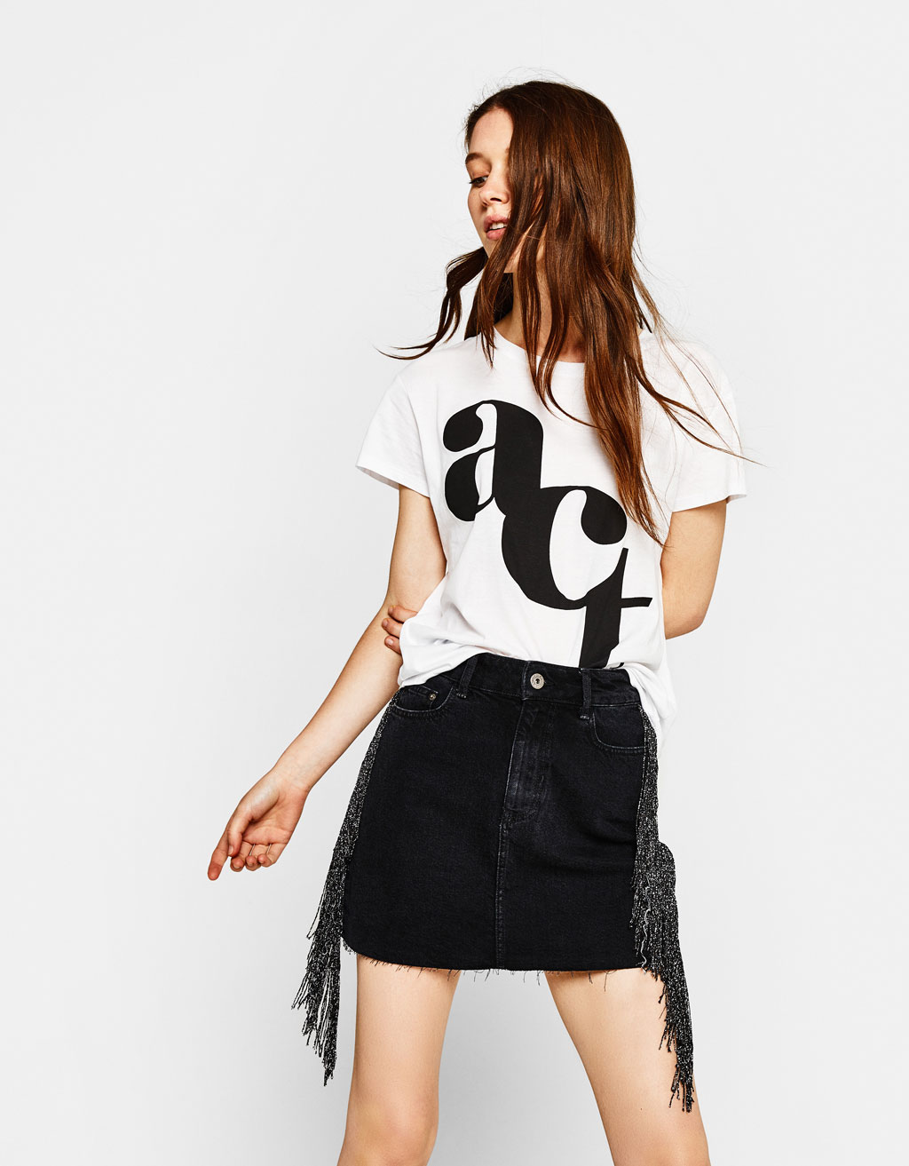Denim skirt with metallic fringe