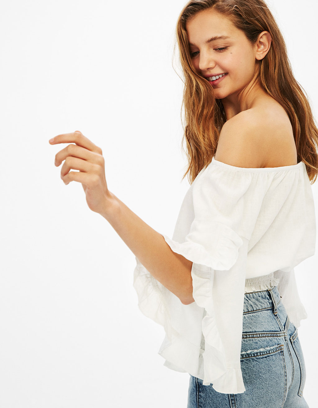 Off-the-shoulder linen blouse with flared sleeves and ruffles