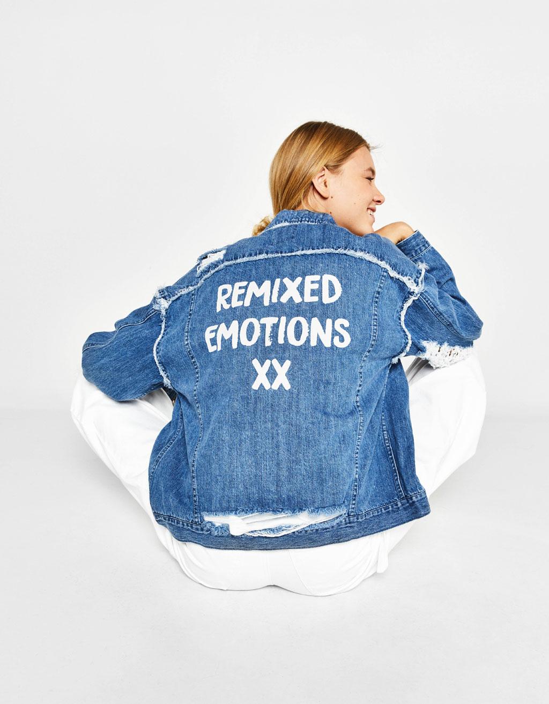 Ripped denim jacket with slogan