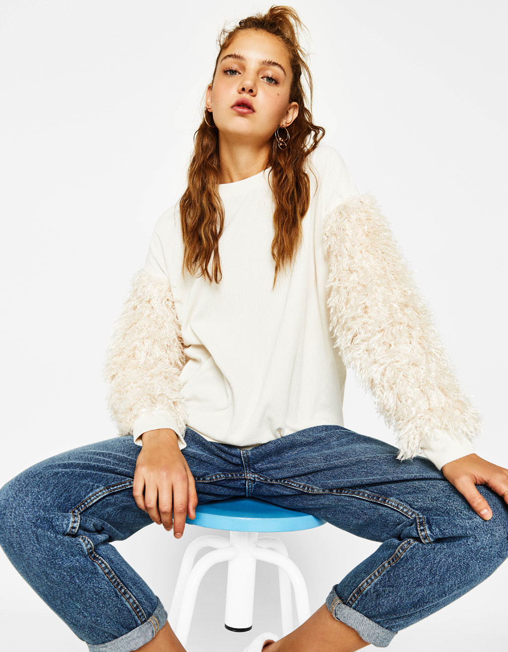 Sweater with faux fur sleeves
