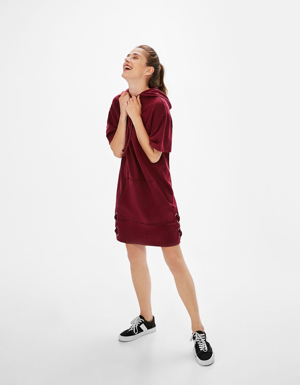 Plush jersey dress with bow on the hem