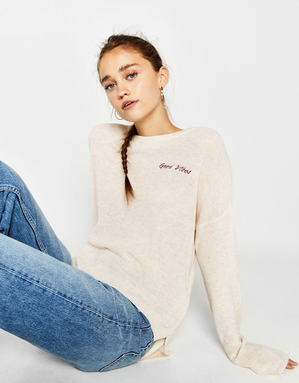 Sweater with embroidered slogan