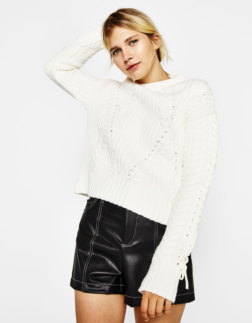 Cable-knit sweater with lace-up detail