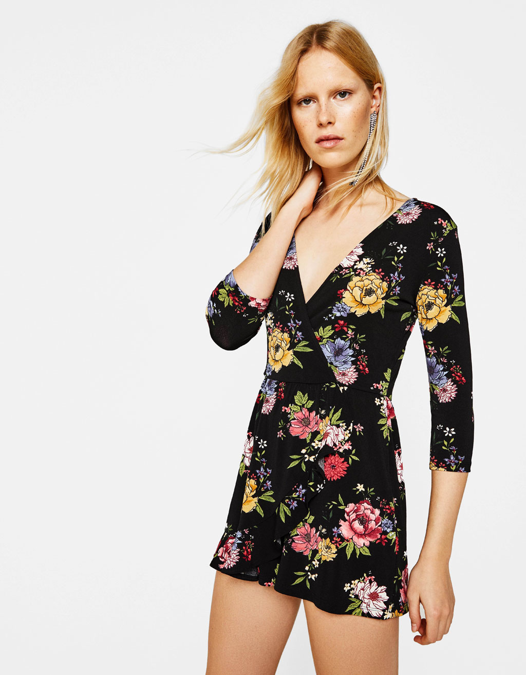 Short jumpsuit with a floral print